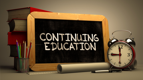 image of a chalkboard saying continuing education along with an alarm clock