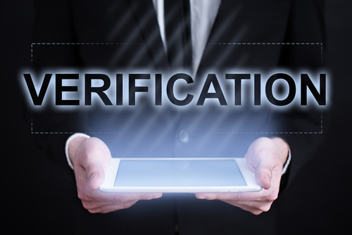 image of a person holding a tablet saying verifications