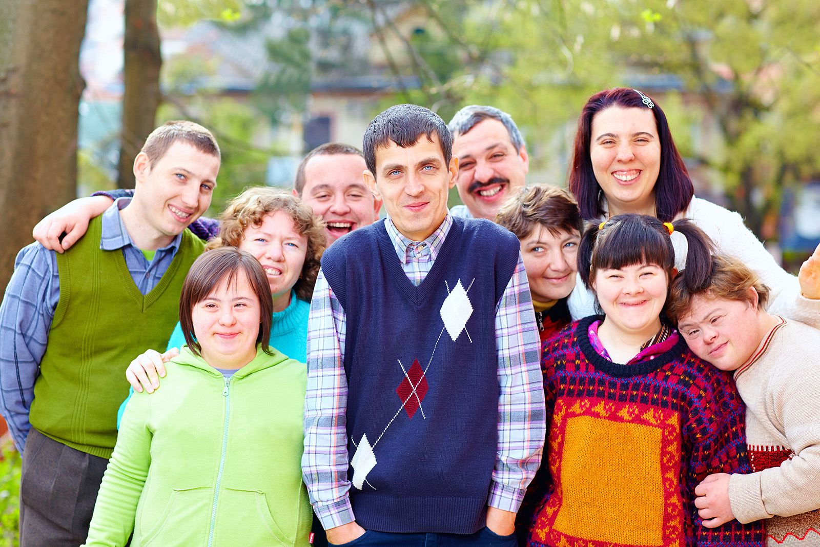 Group of happy people with developmental disabilities